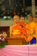 buddhists monks in robes orange