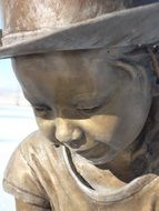 child girl, bronze sculpture