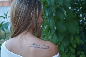 tattoo on the shoulder of a girl