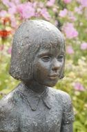 bronze sculpture of a girl