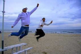 jumping men on the beach