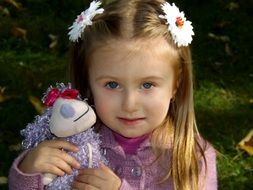 photo of girl with plush toy in the hands