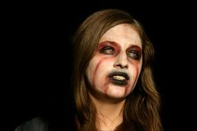 girl\'s face painted for Halloween causes fear and horror