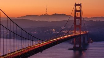 golden gate bridge in the sunset colors