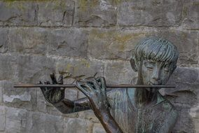 bronze sculpture of flutist
