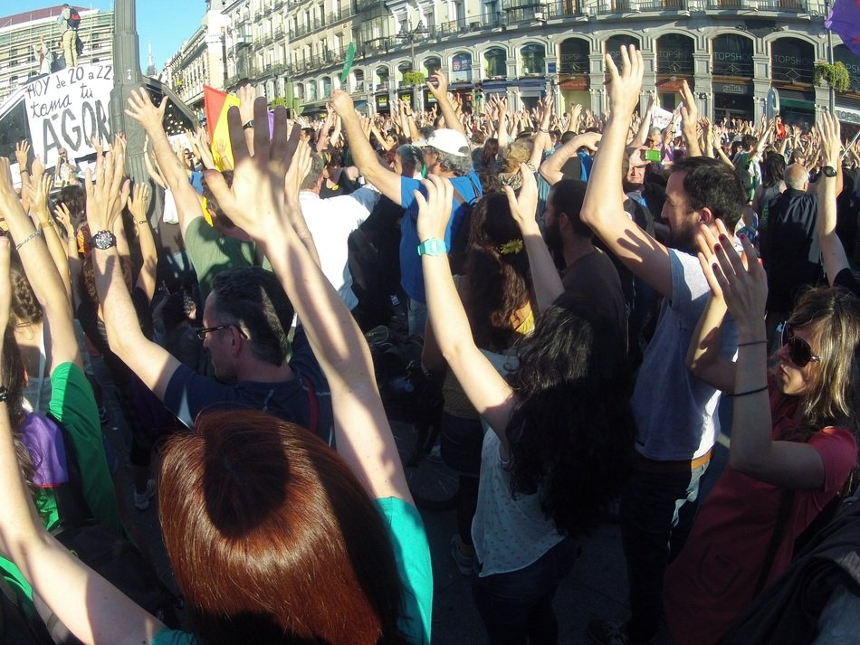 People with their hands up in the square of madrid