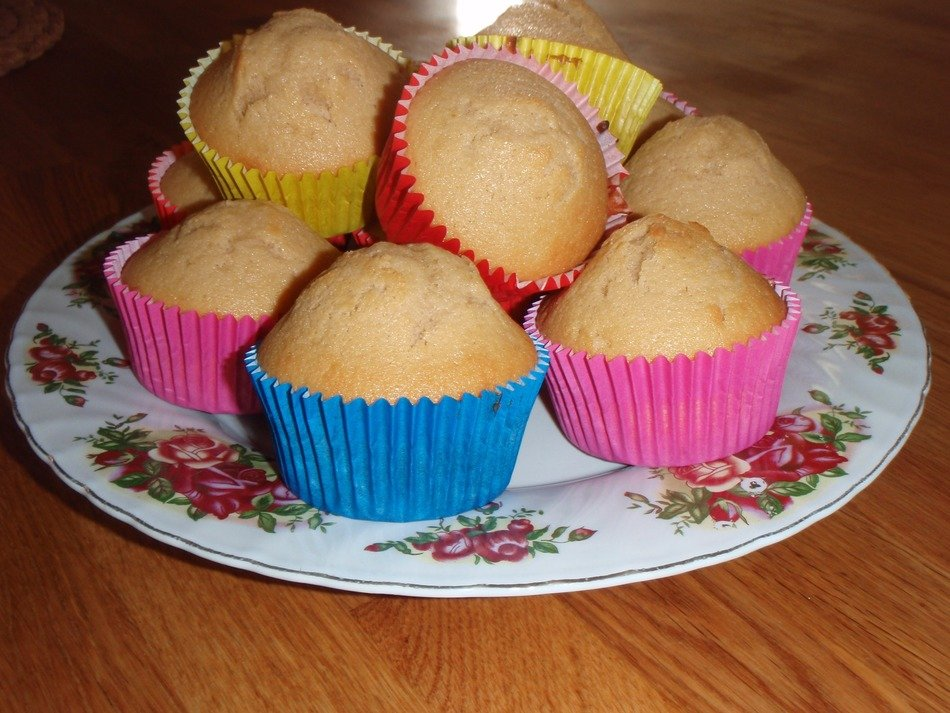 Muffins in colorful paper on a plate
