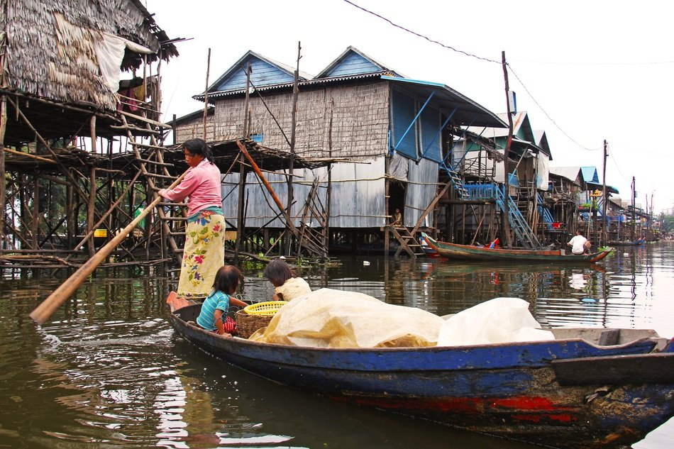 Residents of a floating village in a boat in Cambodia