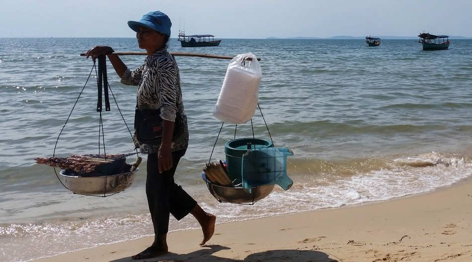 Woman seller on the beach in cambodia