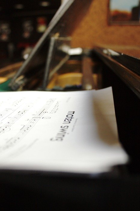 Scores lie on the piano