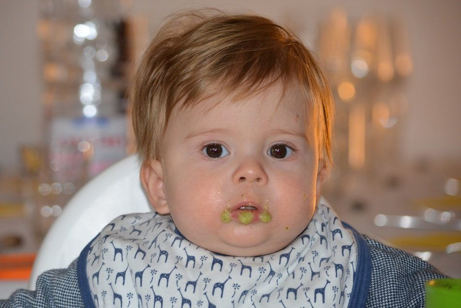 a child with a dirty mouth while eating