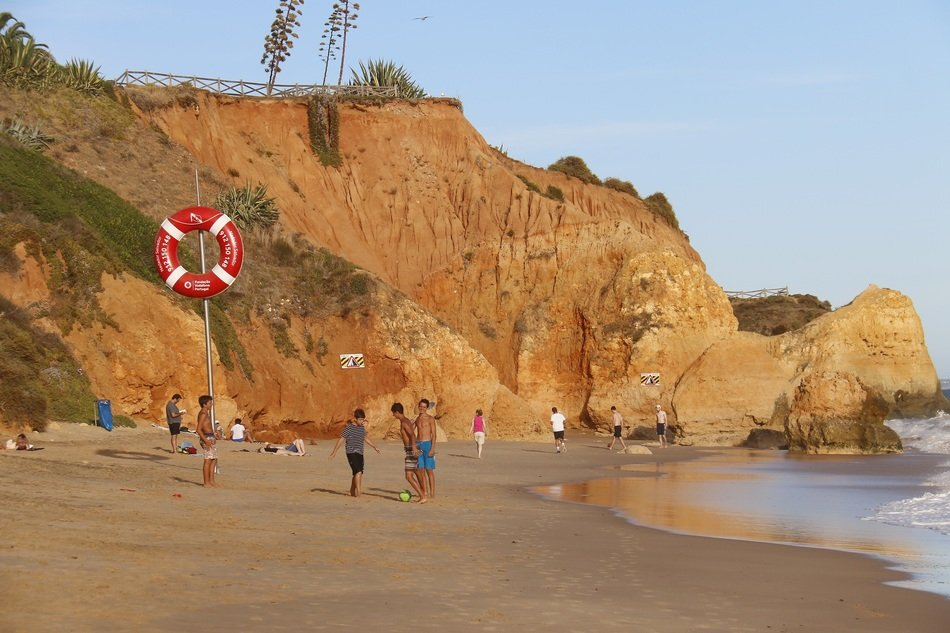 Children are playing on the sandy beach