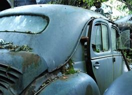 Rear view of a car in a car cemetery