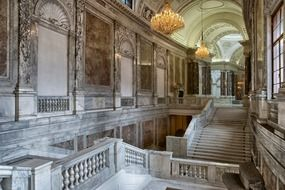 Marble interior and chandeliers in the Hofburg Palace, Austria