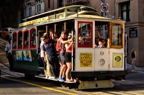 people ride the tram