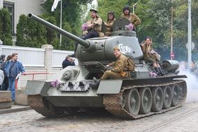 Soldiers on a tank at a military historical parade in Prague