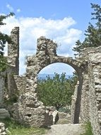 arch among the ruins of a monastery