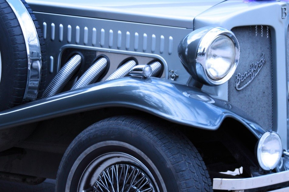Black antique automobile is in retro style