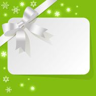 Gift Card with white ribbon on green background snowflakes
