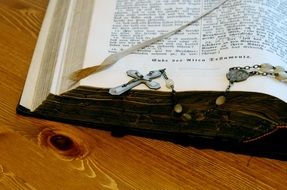 holy bible with a stone crucifix