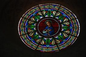 stained glass in a church with the virgin mary
