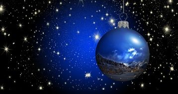 A bright blue Christmas picture inside the ball depicts the landscape