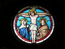 stained glass window of the crucifixion of Jesus
