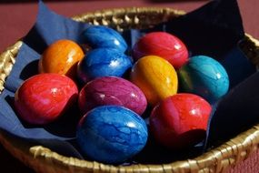 colored Easter eggs in a wicker basket