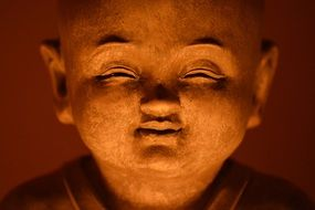 smiling buddha face statue