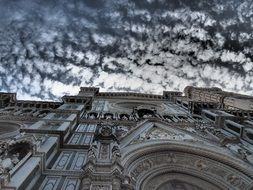 Cathedral of Saint Mary of the Flower, part of facade at cloudy sky, bottom view, italy, florence