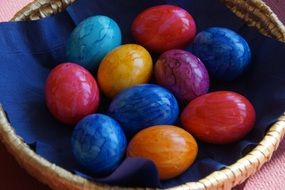 colored eggs in a wicker basket