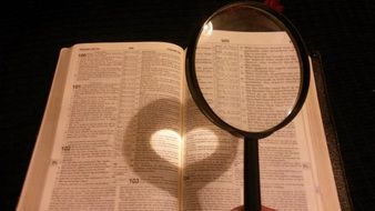 magnifying glass over an open book