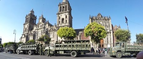 army trucks with soldiers at cathedral, mexico