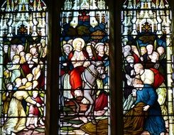 stained glass window with biblical story of the church in England
