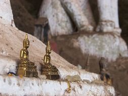 golden statues buddha in laos