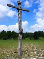 Wooden cross among nature