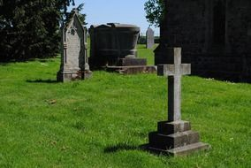 tombstones and stone cross in a cemetery