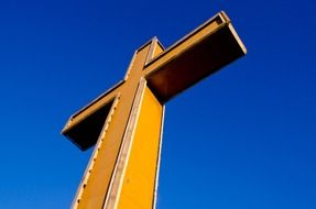 large cross against a bright blue sky
