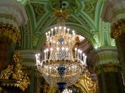 Crystal chandelier under the arches of the palace in St. Petersburg