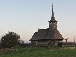 wooden church on a green hill in romania