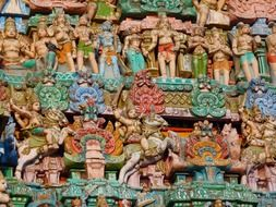 colored figures on a temple in India