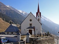 church with steeple at scenic mountains, austria, east tyrol