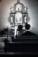photo of the lonely man in a church