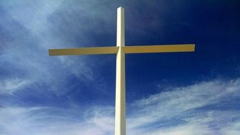 wooden cross on blue sky background