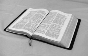 open bible on white table