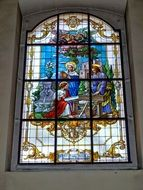 stained glass window with a picture of Jesus Christ