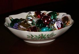 christmas balls in a porcelain bowl