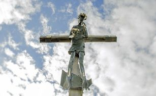 Jesus on the cross against the blue sky