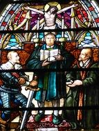 church window with a picture of saints and jesus christ