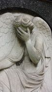 angel crying statue